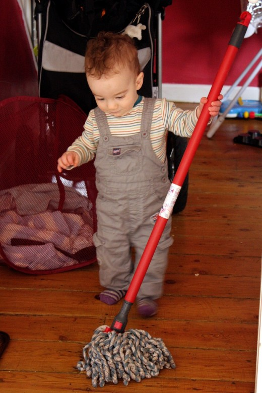 child mops floor