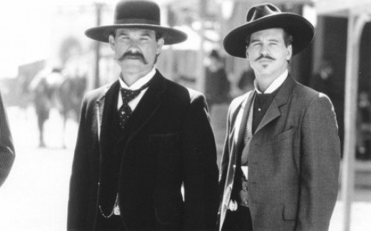 """Kurt Russell as Wyatt Earp and Val Kilmer as Doc Holliday in """"Tombstone"""" (1993)"""