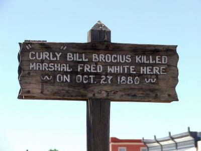 a sign in Tombstone, Arizona marking the place where Fred White was killed by Curly Bill Brocius.