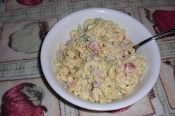 Well here it is, my macaroni salad with chopped green and purple onions, celery, Roma tomatoes and dill pickles.  All wrapped in a slightly sweet and tangy dressing!