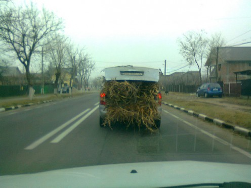 BUDDY, THIS IS A SUV, NOT A GMC PICKUP. YOUR CARELESS USE OF YOUR VEHICLE, HAULING HAY, COULD CAUSE A MAJOR ACCIDENT.