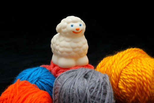SHEEP OVER BALLS OF YARN by Erdosain DESCRIPTION White sheep over balls of yarn. Concep: before and after