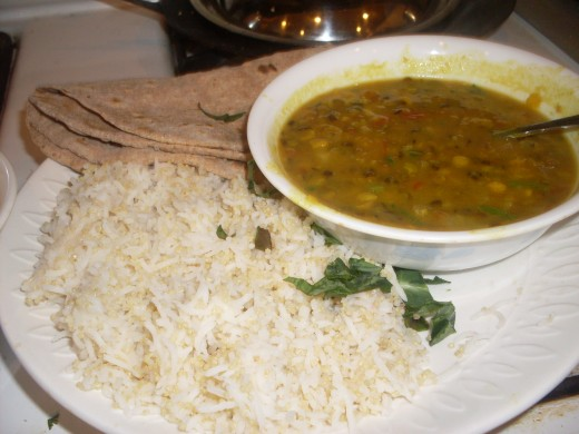 Steamed Rice, lentil Dal and Roti