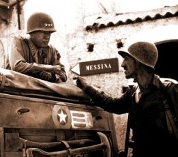 Patton speaking with Lt. Col. Lyle Bernard, at Brolo, circa 1943.