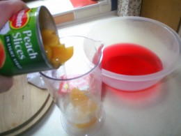 Add tinned fruit to jelly