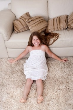 After you treat an oil stain, run a vacuum over the carpet and enjoy the beautiful results.