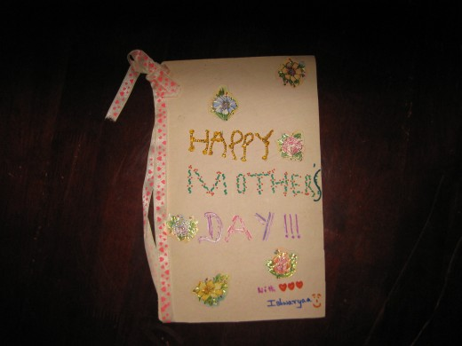 I often made use of thin cardboard paper not only for painting or drawing pictures but also created cards out of them. This card was created by me for my mother on Mother's day a decade ago!