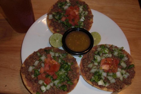Here are my homemade beef and bean tostadas with homemade tomatillo chile!  These were served with fresh sliced lime and iced tea!