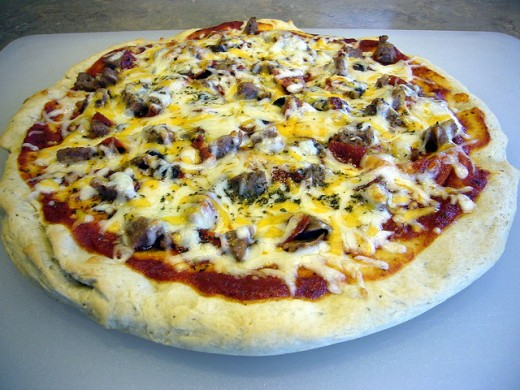 Cheese Pizza Topped with Sausage, Pepperoni & Mushroom