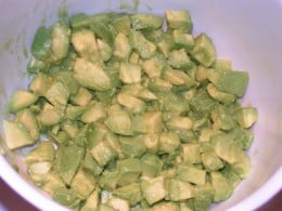 Coat avocado with lime juice to prevent browning.