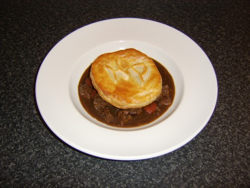 Beef stew with a simply monogrammed puff pastry topping