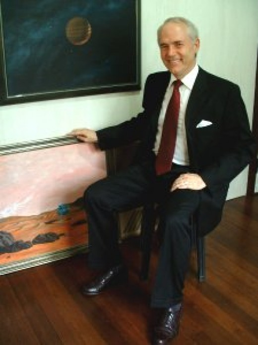 """A more recent picture of me with my painting, """"Taurus Lander."""" Photo credit: Juvy Martin."""