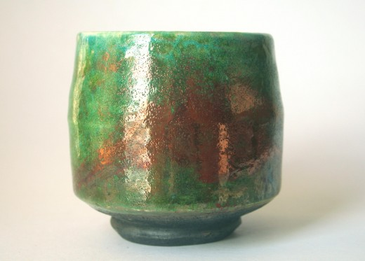 An example of a raku vessel. Note the black colour of the exposed clay at the foot and the metallic lustre of the bright glazes. Potter: Unknown