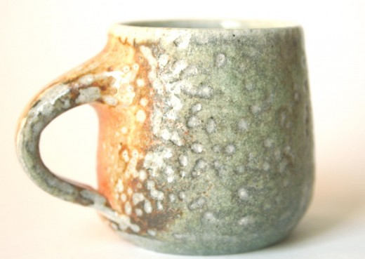 A cup that has been fired in a soda firing. Note the classic 'orange peel' dimples on the surface. Pottery: Maze Hill Pottery, UK
