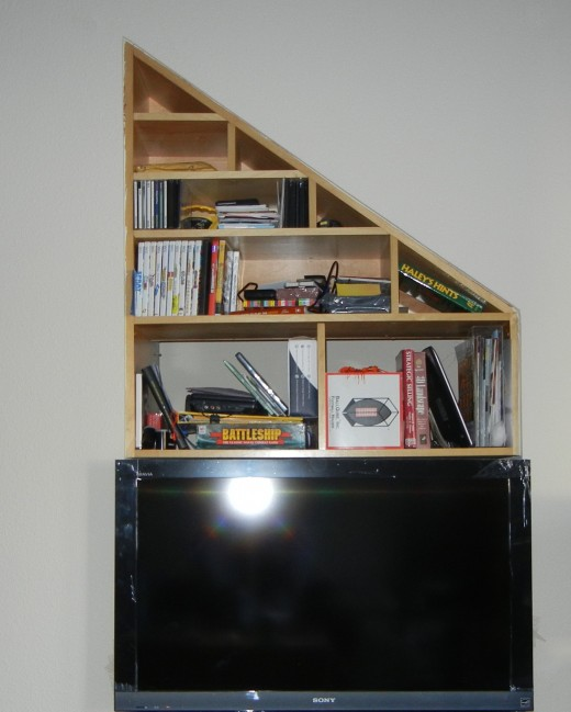 Especially when a black TV sat right underneath it.  I wanted to use something to cover it up.  Something that could cover up the mess but still allow access to that space.