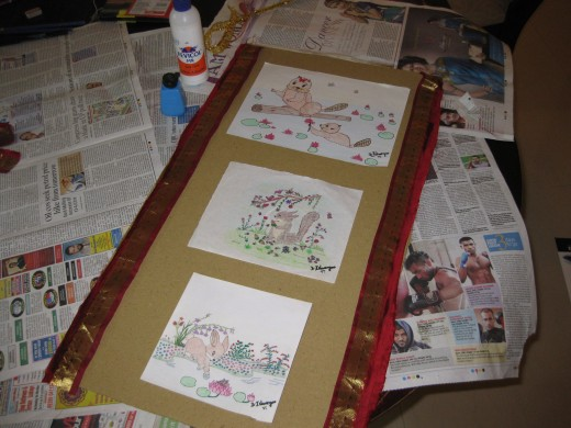 Silk cloth strips are pasted on the edges of the cardboard base to give it an elegant look.