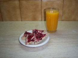 Wholegrain bread, sunflower margarine and a high fruit jam with a glass of fresh orange juice....