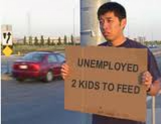 This is sad. Man holding sign in street to feed his kids