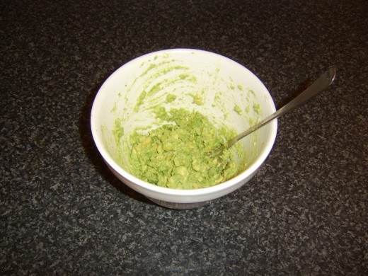 Avocado is mashed with a fork to provide texture