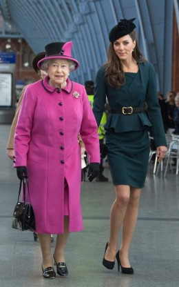 Kate in an LK Bennett dark teal dress with matching jacket.  The Queen in a hot pink(!) Angela Kelly cashmere coat.