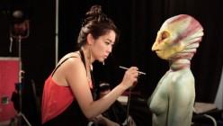 Sue applying makeup