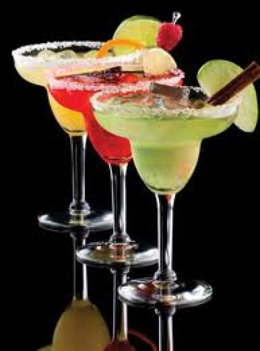 There are many versions to the basic margarita recipe.  Shown here are mango, strawberry and the ever popular classic margarita.