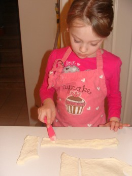 Spreading the butter on the dough is fun!