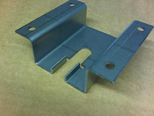 Mild steel sheet metal brackets used on top of a mild steel speaker cabinet.