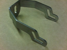 Stainless steel laser cut brackets for medical equipment.