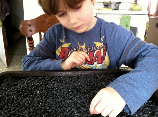 My 6 year old son, helping to sort through black beans before cooking
