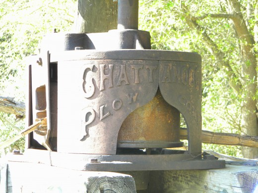 An old cane mill, or press.  Used to extract the sweet cane juice from the stalks for boiling down into cane syrup.  An important staple of many southern states.