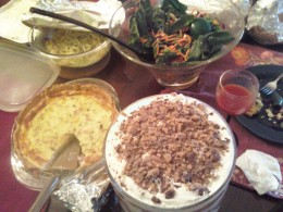 A sampling of the dishes at the Potluck- shrimp scampi, a salad, a quiche and a a trifle for dessert.