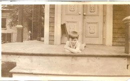 Little boy on a porch