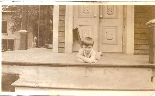 Little boy on a porch