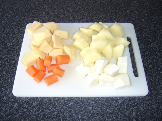 Root vegetables are chopped to uniform, bite-sized pieces