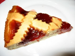 Slice of Homemade Strawberry Pie with Lattice Covering