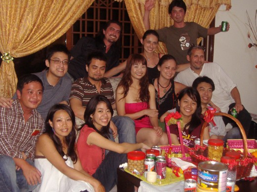 All the cousins bar 3. Plus 2 in-laws. New Year's Day evening in Eldest Uncle's house. Just snacking.