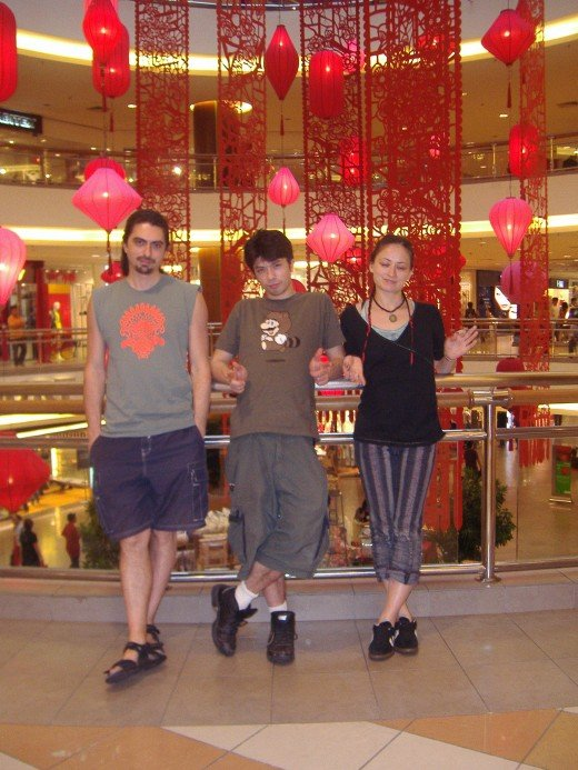 Three siblings,Ben and Tara from NY, with Danny in the middle.   In a mall decorated for Chinese New Year.