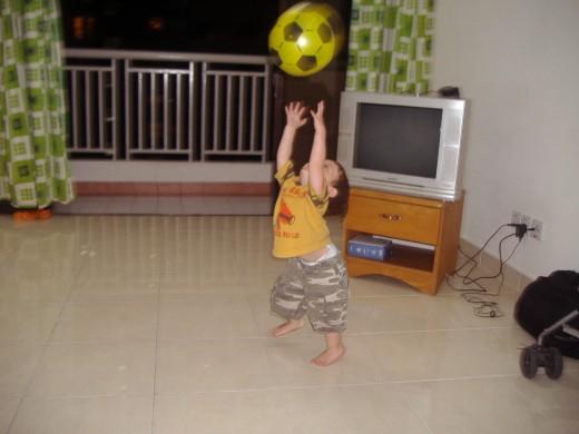Ronan in Kuala Lumpur with his soccer ball.