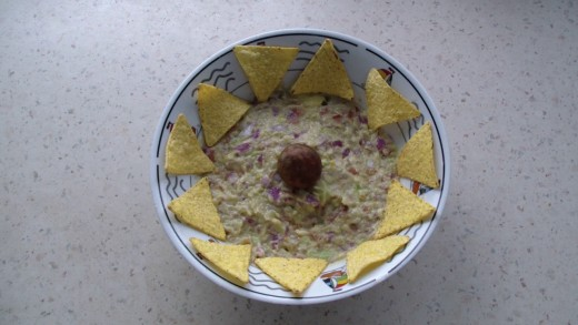 Guacamole and doritos. (pit is left to conserve the avocado color, or so they say it should)