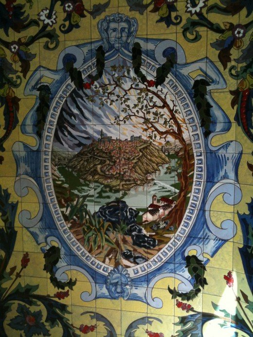 A mosaic of Toledo perched high on a mountain top above the Tagus River. This tile work is found at the entrance to the supermercado.