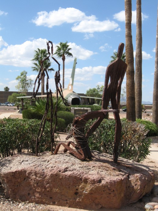 POW sculpture at Davis-Monthan AFB with aircraft in background