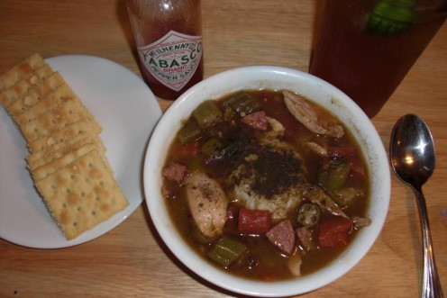 Here is my homemade chicken and andouille sausage gumbo served with Tabasco, saltine crackers and iced tea with lime.  A great meal indeed!