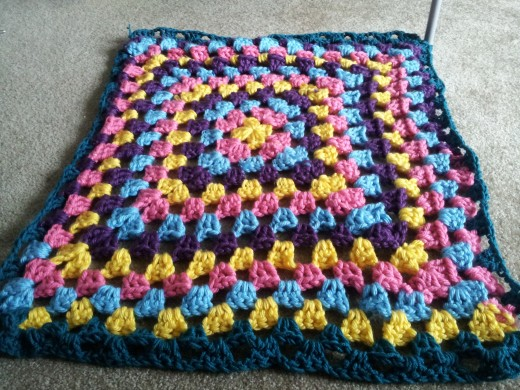 made this super easy afghan in 2 hours with bulky yarn (pic taken at day)