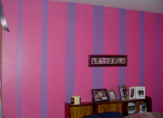 Painted purple and pink striped wall