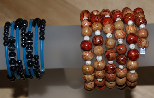 Rubber tube cord, Hematite beads, and cat's eye beads were used in the bracelet on the left.  Painted wooden beads and magnesite beads were used in the bracelet on the right.