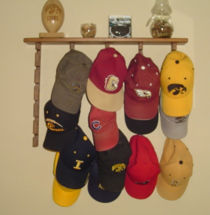 Baseball cap holder with five hanging units and shelf on top