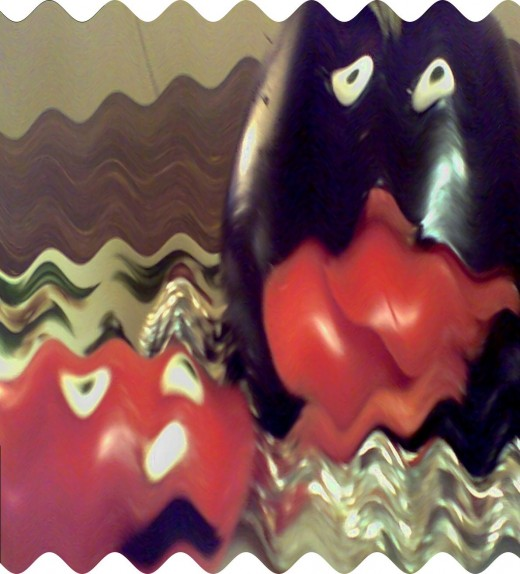 """I make sculptures with veggies & objects, this is from an old movie poster; """"Attack of the Eggplants!"""""""