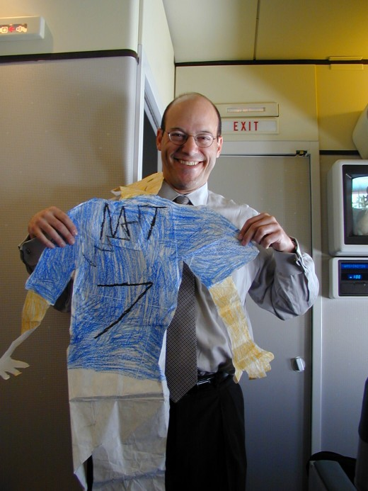 Then- White House Spokesman Ari Fleischer holding a Flat Stanley in the press cabin of Air Force One in 2002.