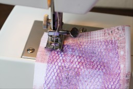 Sew, attaching the two edges and stiffer fabric